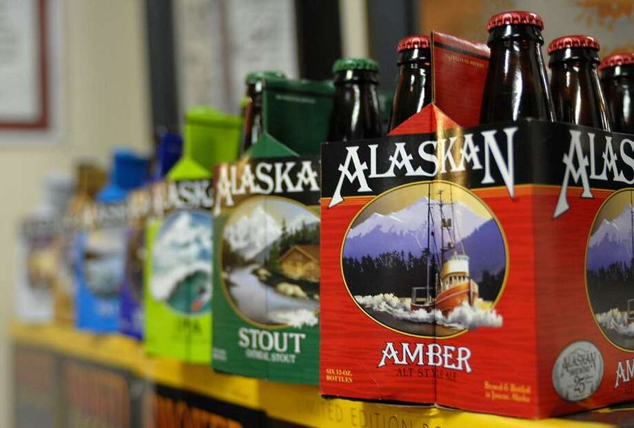 In this photo taken Jan 23, 2013, in Juneau, Alaska, are six-packs of beer displayed at the Alaskan Brewing Co. The brewery has installed a unique boiler system that burns the company's spent grain the accumulated waste from the brewing process into steam which powers the majority of the plant's operations. (AP Photo/Joshua Berlinger) Photo: AP / AP2013