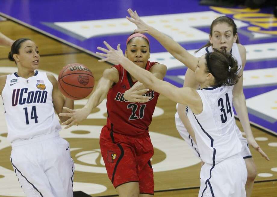 Louisville guard Bria Smith (21) passes the ball against Connecticut guard Kelly Faris (34) during first half of the national championship game of the women's Final Four of the NCAA college basketball tournament, Tuesday, April 9, 2013, in New Orleans. (AP Photo/Bill Haber) Photo: AP / FR170136 AP