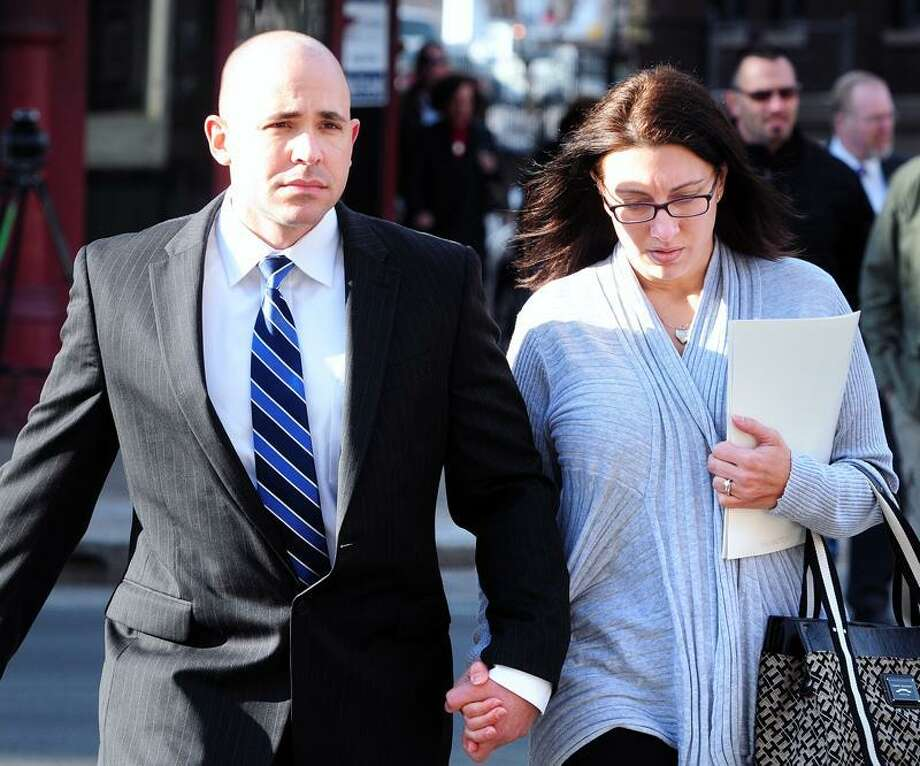 Former East Haven Police Officer Jason Zullo (left) walks into U.S. District Court in Hartford with his wife for sentencing on 1/8/2013.Photo by Arnold Gold/New Haven Register   AG0479D