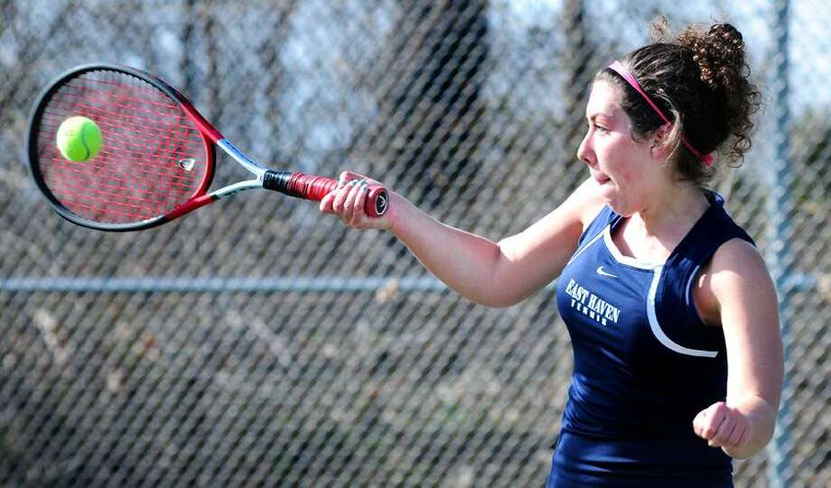 Eliza Gladwin of East Haven hits a forehand to Kristen Forscher of Guilford during a match at Guilford Tuesday. Forscher won in straight sets. Photo by Arnold Gold/New Haven Register