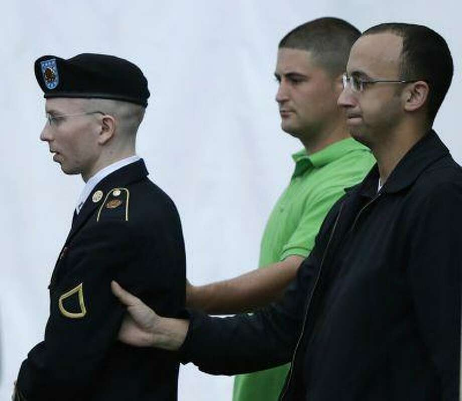 U.S. Army Private First Class Bradley Manning (L) departs the courtroom after day four of his court martial at Fort Meade, Maryland June 10, 2013. (Gary Cameron/Reuters) Photo: Reuters / X00044