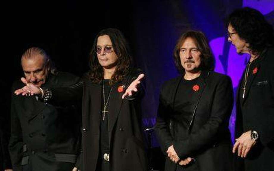Original members of the rock band Black Sabbath (L-R), Bill Ward, Ozzy Osborne, Geezer Butler and Tony Lommi, announce the reunion of the rock group at the Whiskey A Go Go, the club where the band first performed 41 years ago, at 11:11 a.m. on 11/11/11 in Los Angeles, Calif.November 11, 2011. (REUTERS/David McNew) / X00184