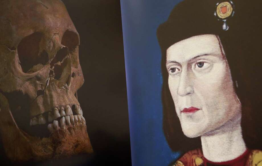 A television image of King Richard III's skull is seen next to a portrait of him during a news conference in Leicester, central England Feb. 4, 2013. (Darren Staples/Reuters) Photo: REUTERS / X01323
