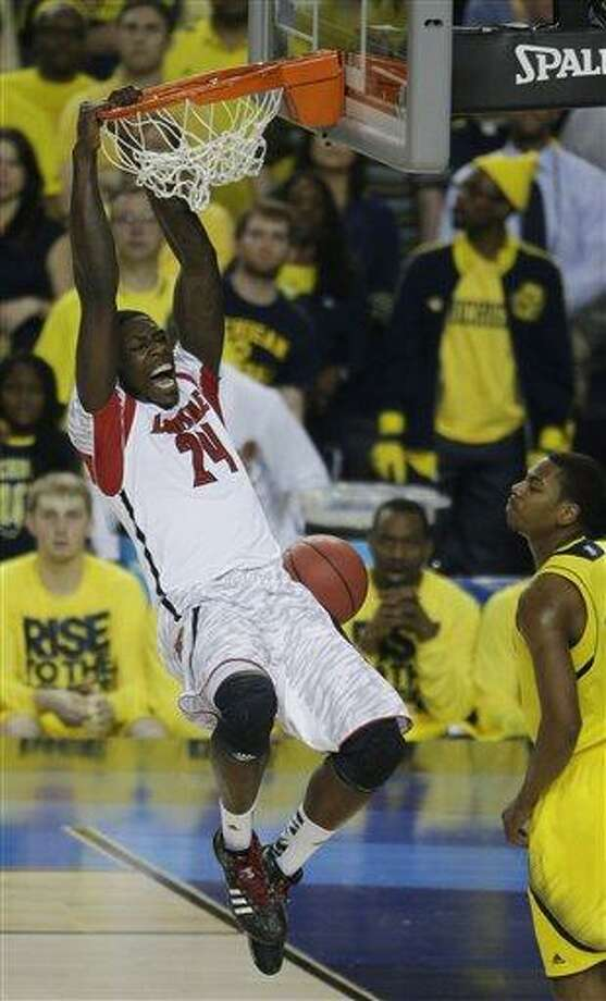 Louisville forward Montrezl Harrell (24) dunks the ball against Michigan during the first half of the NCAA Final Four tournament college basketball championship game Monday, April 8, 2013, in Atlanta. (AP Photo/Chris O'Meara) Photo: AP / AP