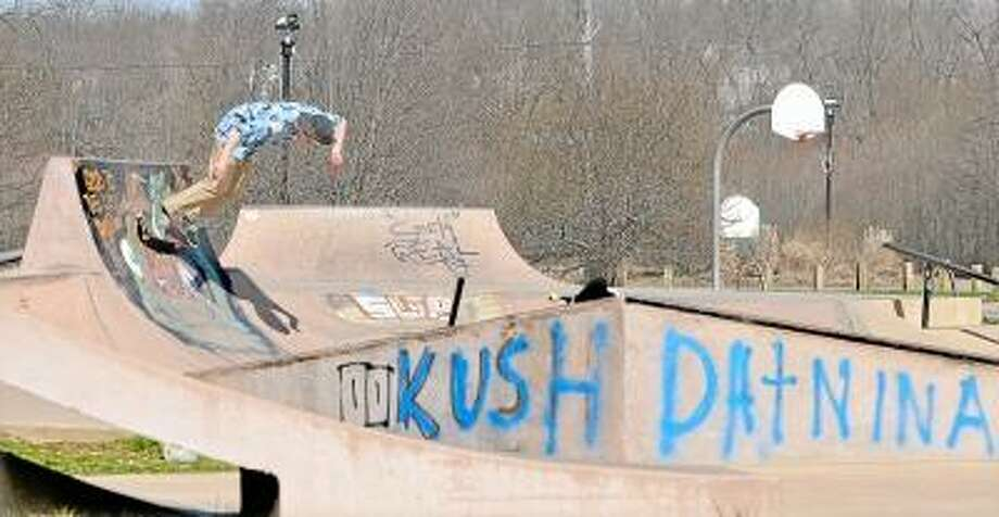 """Catherine Avalone/The Middletown Press  Brenen Branciforte, 20, of Cromwell skates at the Peckham Skate Park in Middlefield which has been riddled in graffiti and tagging. Branciforte said, """"It's an eyesore."""" / TheMiddletownPress"""
