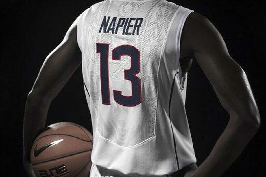 This undated photo provided by the University of Connecticut via Nike on Thursday, April 18, 2013, shows the school's new NCAA college basketball uniform. The new uniform comes out of a marketing partnership between the school's athletic department and Nike, which helped design it at no cost to the school. (AP Photo/Nike via University of Connecticut, Todd Eckelman) Photo: AP / University of Connecticut
