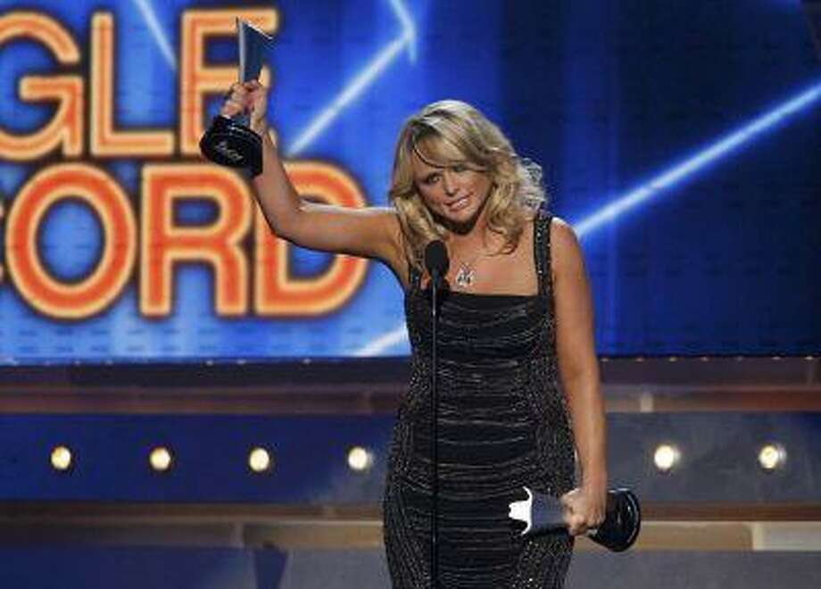 "Miranda Lambert accepts the single record of the year award for ""Over You"" during the 48th ACM Awards in Las Vegas April 7, 2013. REUTERS/Mario Anzuoni (UNITED STATES Tags: Entertainment) (ACM-SHOW) Photo: REUTERS / X90045"