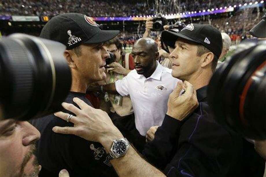 San Francisco 49ers head coach Jim Harbaugh, left, greets Baltimore Ravens head coach John Harbaugh after the Ravens defeated the 49ers 34-31 in the NFL Super Bowl XLVII football game, Sunday, Feb. 3, 2013, in New Orleans. (AP Photo/Dave Martin) Photo: ASSOCIATED PRESS / AP2013