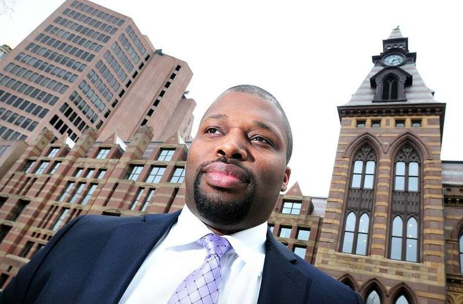 Mayoral candidate Gary Holder-Winfield is photographed across from City Hall in New Haven on 4/11/2013.Photo by Arnold Gold/New Haven Register   AG0492B