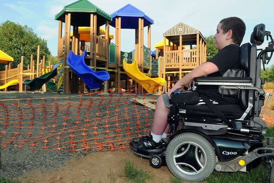 """Josh Tramontano, age 14 of Hamden was the inspiration for an all abilities playscape at the Hamden Town Center Park. Today he got a look at the construction of it, about a decade after it was first proposed. Mara Lavitt/New Haven Register <a href=""""mailto:mlavitt@newhavenregister.com"""">mlavitt@newhavenregister.com</a>5/31/13"""