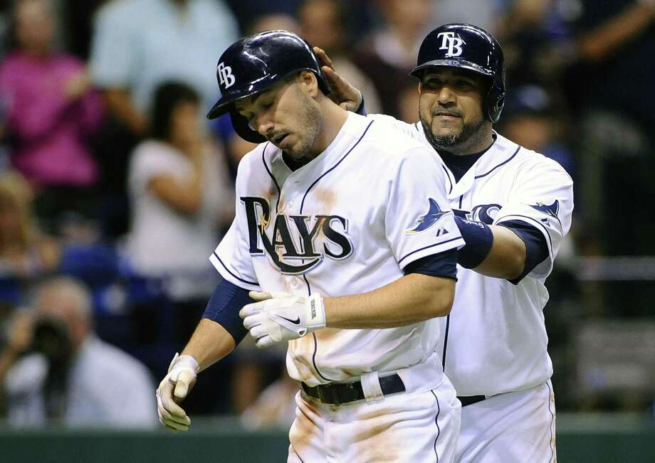 Tampa Bay Rays Matt Joyce, left, and Jose Molina celebrate at the plate after both scored off of Joyce's two-run home run during the fifth inning of a baseball game against the Boston Red Sox Tuesday, June 11, 2013, in St. Petersburg, Fla. (AP Photo/Brian Blanco) Photo: AP / FR1701907 AP