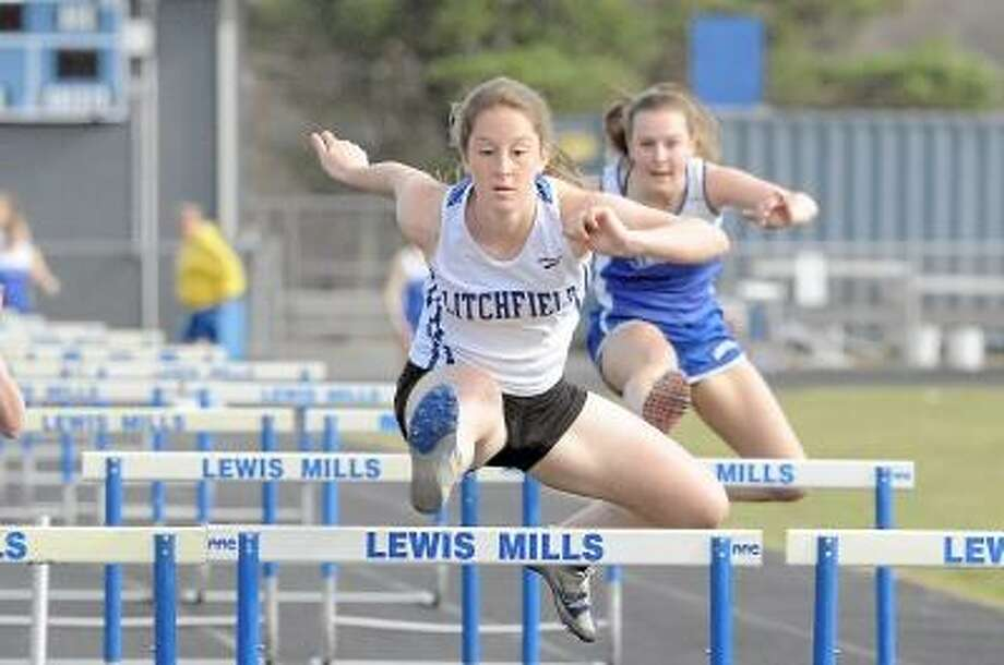 Laurie Gaboardi/Register Citizen Litchfield's Emily Andrulis competes in the hurdles against Lewis Mills.