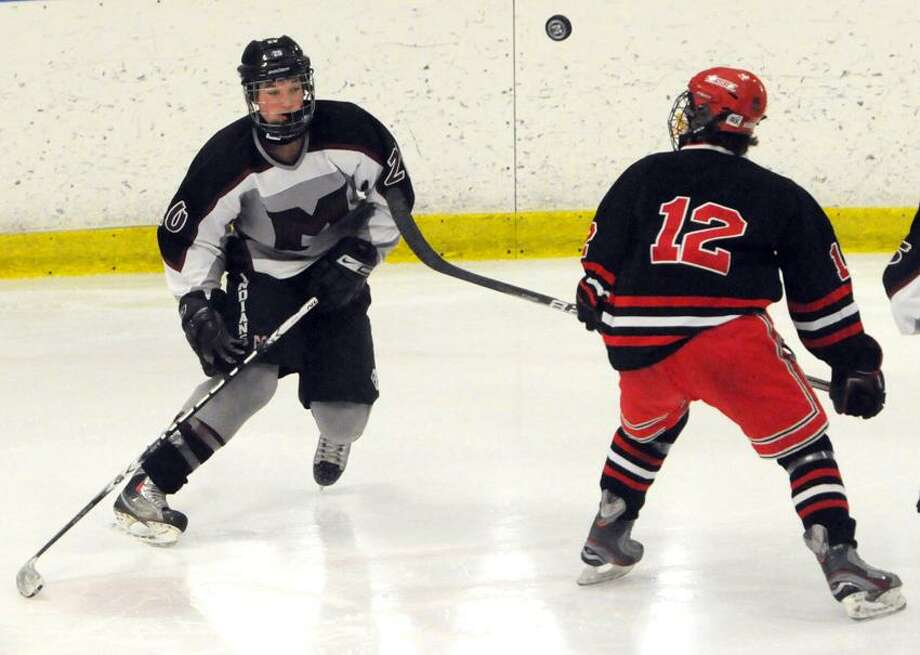 David McLenithan of Milford H.S. left, and Luke Vendetto of Cheshire H.S.  right, during 2nd period hockey action at the Milford Ice Pavilion in Milford, Conn. Saturday, February 2, 2013.  Photo by Peter Hvizdak / New Haven Register Photo: New Haven Register / ©Peter Hvizdak /  New Haven Register
