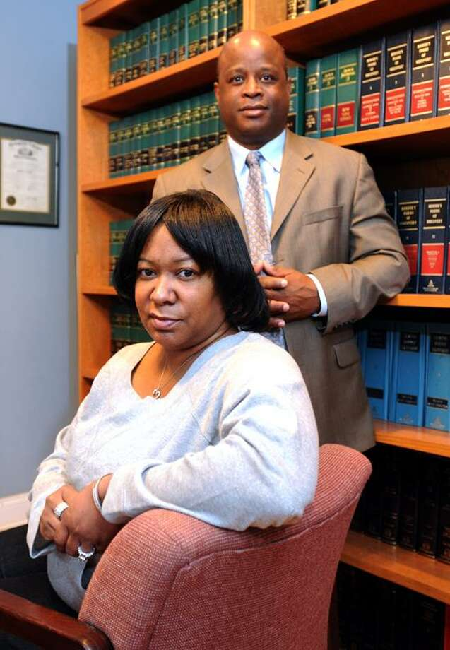 Virginia Williams with her Attorney Jerald Barber in Barber's New Haven office Friday January 11, 2013. Williams, whose son was killed in 2011, is suing the Hospital of St. Raphael's for staff taking photos of her son's  body and texting them to others.   Photo by Peter Hvizdak / New Haven Register Photo: New Haven Register / ©Peter Hvizdak /  New Haven Register