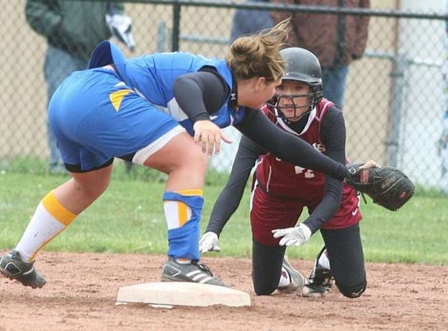 PHOTO BY JOHN HAEGER @ONEIDAPHOTO ON TWITTER - ONEIDA DAILY DISPATCH Stockbridge Valley's Sam Yates (7) is tagged out at second by Madison's Shana Biedermann (11) during their Section III quarterfinal. Both players were First-Team CCL All-Stars.