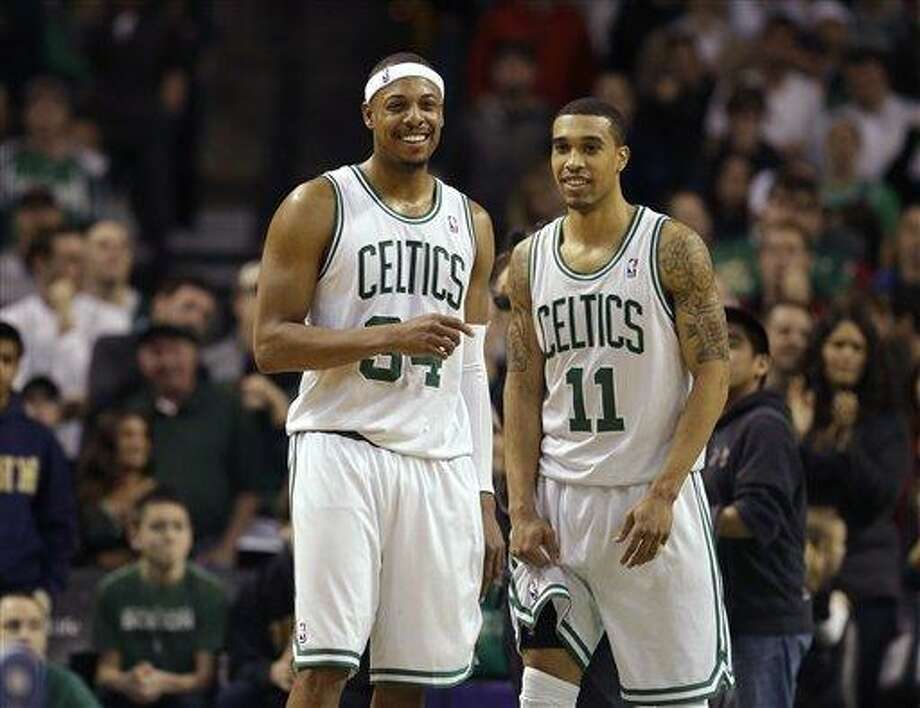 Boston Celtics forward Paul Pierce (34), left, and Celtics guard Courtney Lee (11), right, react seconds after the end of an NBA basketball game against the Los Angeles Clippers in Boston, Sunday, Feb. 3, 2013. The Celtics defeated the Clippers 106-104. (AP Photo/Steven Senne) Photo: ASSOCIATED PRESS / AP2013