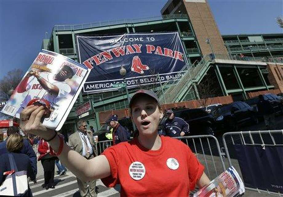 Caitlin Klinger of Somerville, Mass. sells programs outside Fenway Park prior to a baseball game at between the Boston Red Sox and the Baltimore Orioles in Boston, Monday, April 8, 2013. (AP Photo/Elise Amendola) Photo: AP / AP