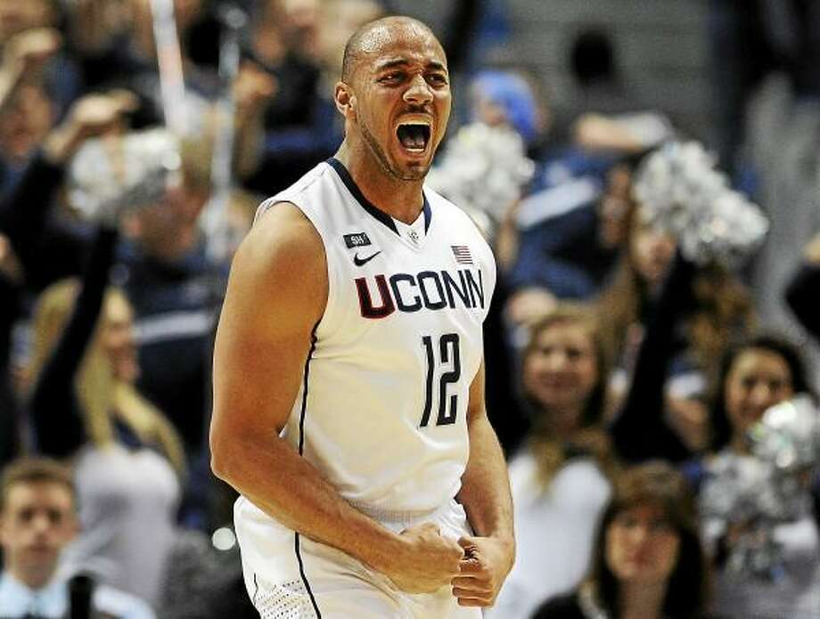 Connecticut's R.J. Evans reacts after being fouled while making a basket during the first half of an NCAA college basketball game against Syracuse in Hartford, Conn., Wednesday, Feb. 13, 2013.(AP Photo/Jessica Hill) Photo: ASSOCIATED PRESS / A2013