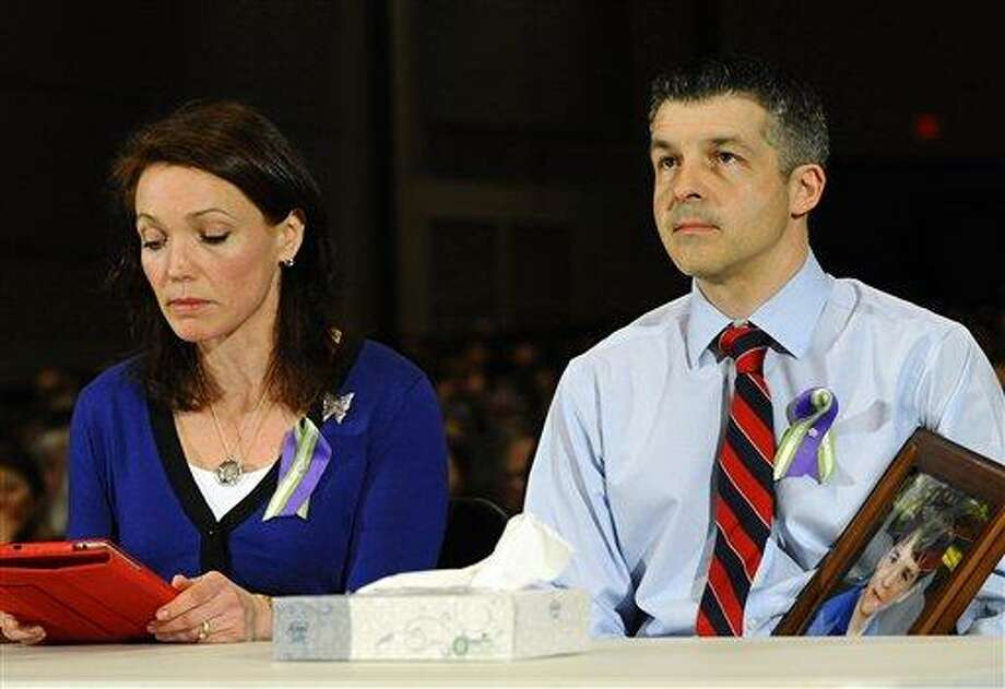 Nicole and Ian Hockley, parents of Sandy Hook School shooting victim Dylan, testify during a hearing of a legislative task force on gun violence and children's safety at Newtown High School in Newtown, Conn., Wednesday, Jan. 30, 2013. Connecticut lawmakers are in Newtown for the hearing, where those invited to give testimony include first responders and families with children enrolled at Sandy Hook Elementary. (AP Photo/Jessica Hill) Photo: AP / FR125654 AP
