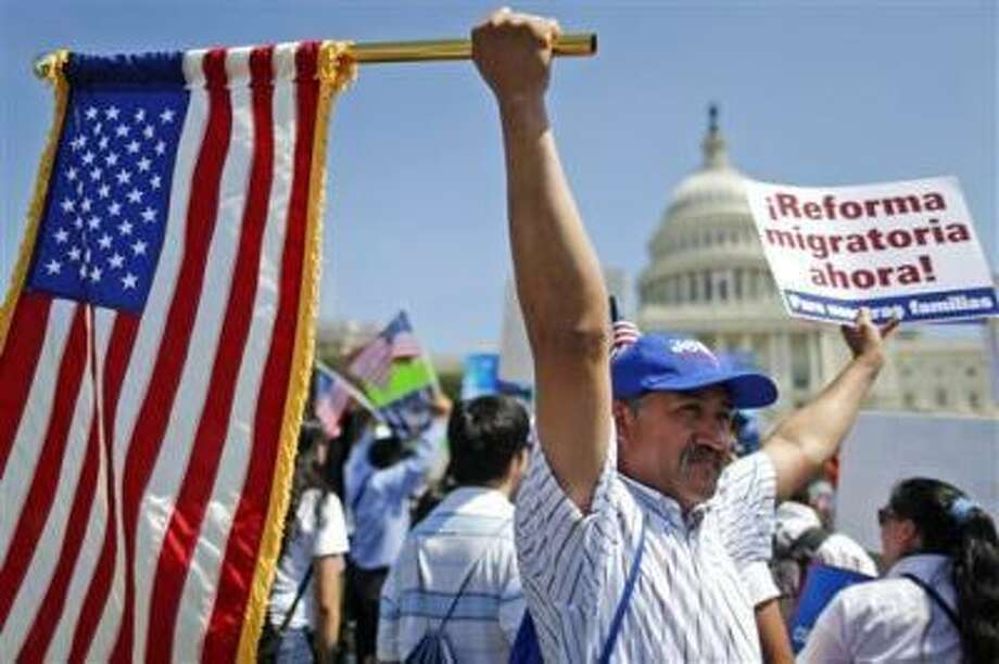 Rigoberto Ramos from Seaford, Del., originally from Guatemala, rallies for immigration reform in front of the U.S. Capitol in Washington, Wednesday, April 10, 2013. (AP Photo/Charles Dharapak) Photo: AP / AP