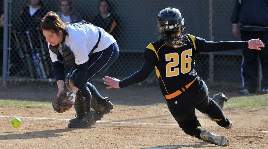 """East Haven-- Amity's Theresa Marchitto slides into home plate safely as East Haven's Briana Spadacenta fields the throw last week. Amity beat Branford on Monday. Photo-Peter Casolino/Register  <a href=""""mailto:pcasolino@newhavenregister.com"""">pcasolino@newhavenregister.com</a>"""