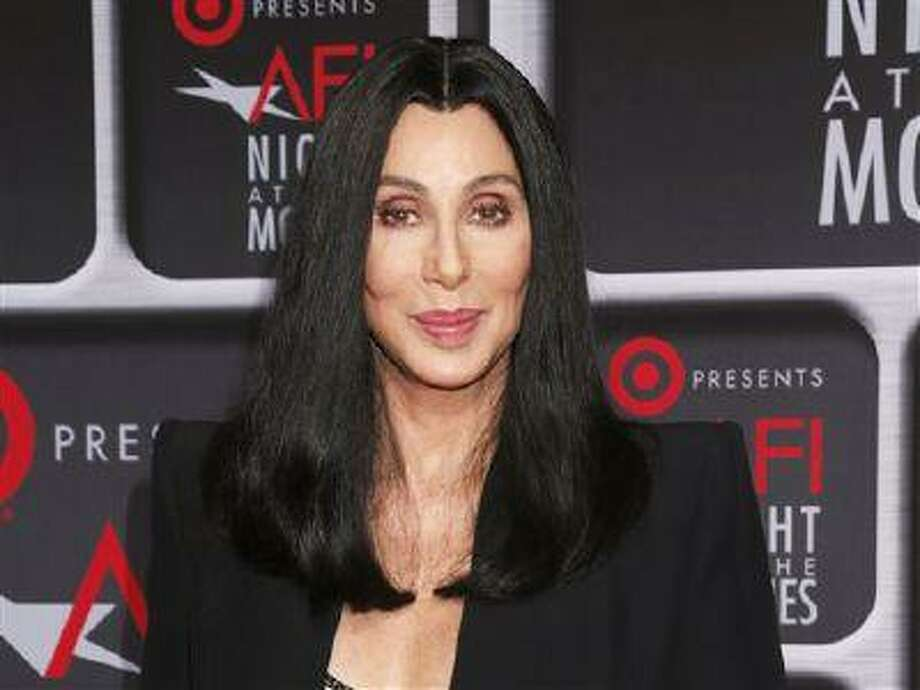 """FILE - This April 24, 2013 file photo shows performer Cher at the AFI Night at the Movies at the ArcLight in Los Angeles. Cher will be performing on the singing competition series """"The Voice"""" during the season finale on Tuesday, June 18. She will perform """"Woman's World"""" the first single off of her upcoming album. (Photo by Todd Williamson/Invision/AP, file) Photo: Todd Williamson/Invision/AP / Invision"""
