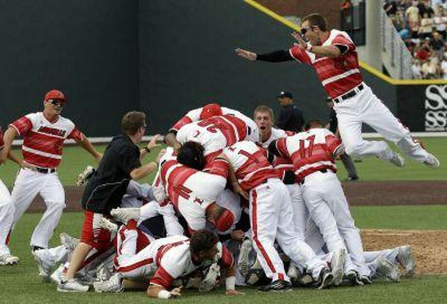Louisville players celebrate after beating Vanderbilt in an NCAA college baseball tournament super regional game on Sunday, June 9, 2013, in Nashville, Tenn. Louisville won 2-1 to advance to the College World Series. (AP Photo/Mark Humphrey) Photo: AP / AP