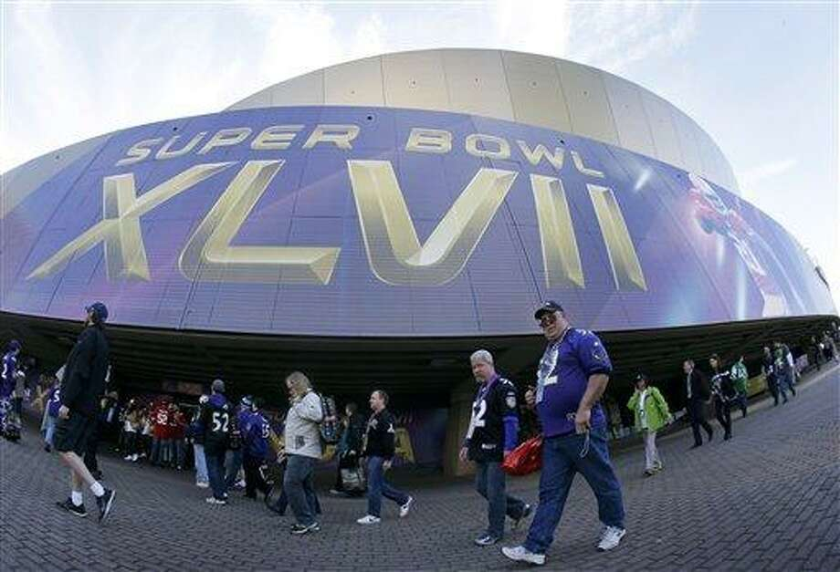Fans walk outside the Superdome before the NFL Super Bowl XLVII football game between the San Francisco 49ers and the Baltimore Ravens Sunday, Feb. 3, 2013, in New Orleans. (AP Photo/Mark Humphrey) Photo: ASSOCIATED PRESS / AP2013
