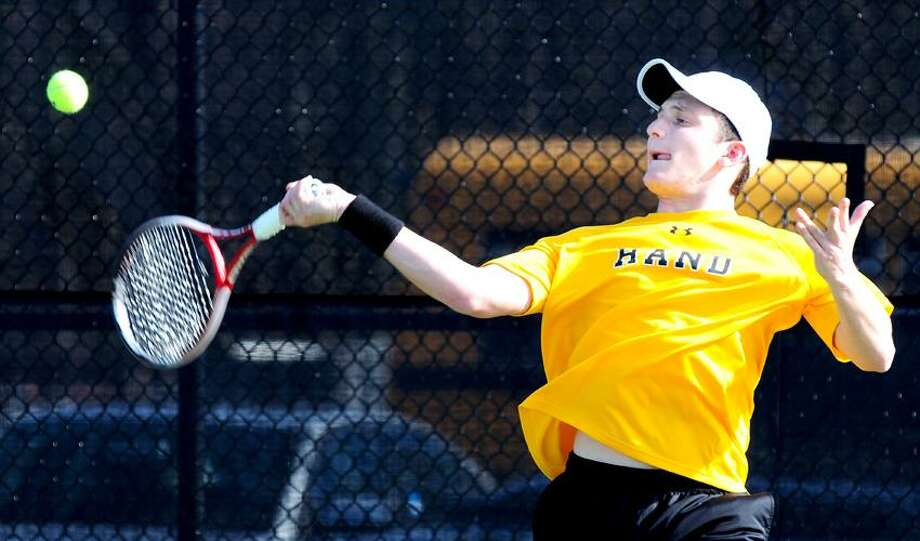 Scott Rubinstein of Hand hits a forehand to Phil Hochman of Amity during a singles match won by Rubinstein. Hand won the match. Photo by Arnold Gold/New Haven Register