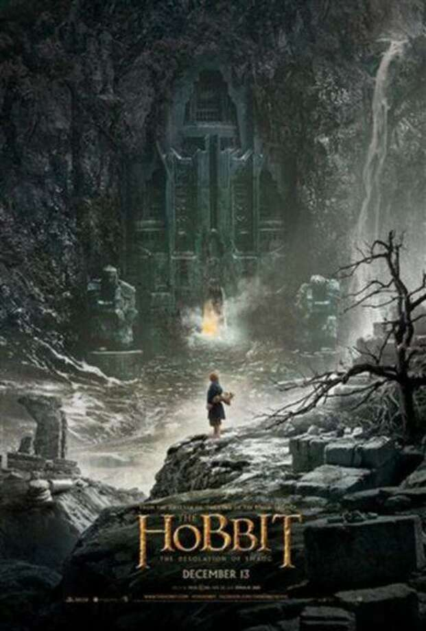 """In this image uploaded on social media by New Zealand movie director Peter Jackson, the poster for """"The Hobbit: The Desolation of Smaug,"""" directed by Jackson, is shown. Hobbits, elves and dragons appear to be luring tourists to New Zealand as fans await their first glimpse of the second movie in """"The Hobbit"""" trilogy. Warner Bros. announced Monday, June 10, 2013 it will release the first teaser-trailer of """"The Hobbit: The Desolation of Smaug"""" at 1 p.m. EDT Tuesday. The second film will premiere Dec. 13 in Los Angeles. (AP Photo/Peter Jackson) MANDATORY CREDIT Photo: AP / Peter Jackson"""
