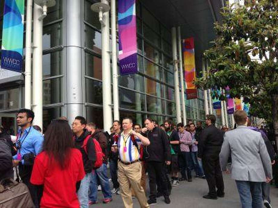 Participants begin to enter the Apple Worldwide Developers Conference at Moscone West in San Francisco.