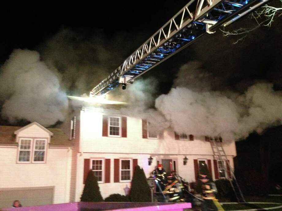 Branford house afire was under renovation. No one was home. Photo by Charlie Ahern