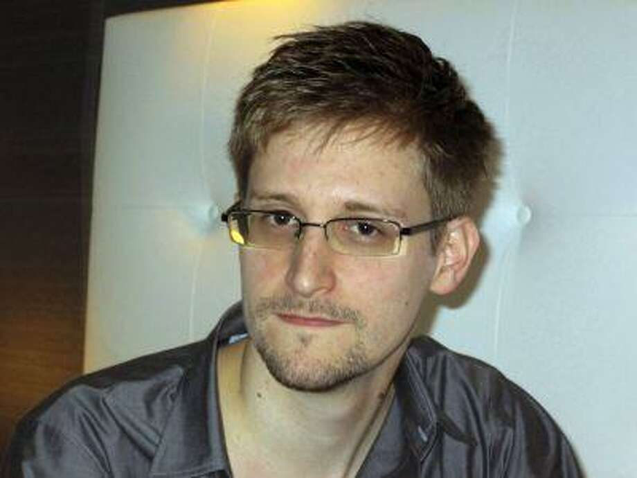 U.S. National Security Agency whistleblower Edward Snowden, an analyst with a U.S. defence contractor, is pictured during an interview with the Guardian in his hotel room in Hong Kong June 9, 2013. (Ewen MacAskill/The Guardian/Reuters) Photo: REUTERS / X80001