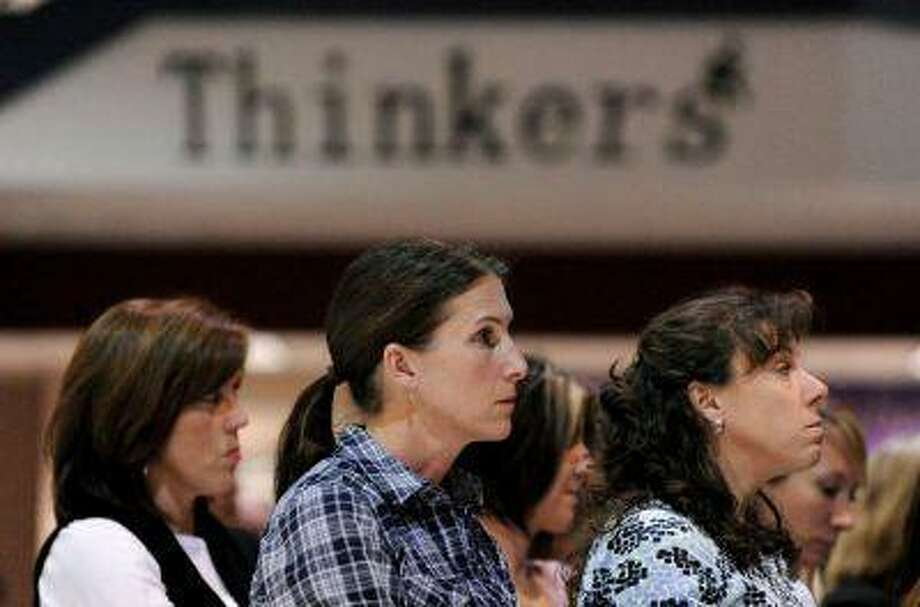 Meg Masten, mother of two students, front center, at a Douglas County school district meeting in 2011. (Hyoung Chang/ The Denver Post) Photo: DP / THE DENVER POST
