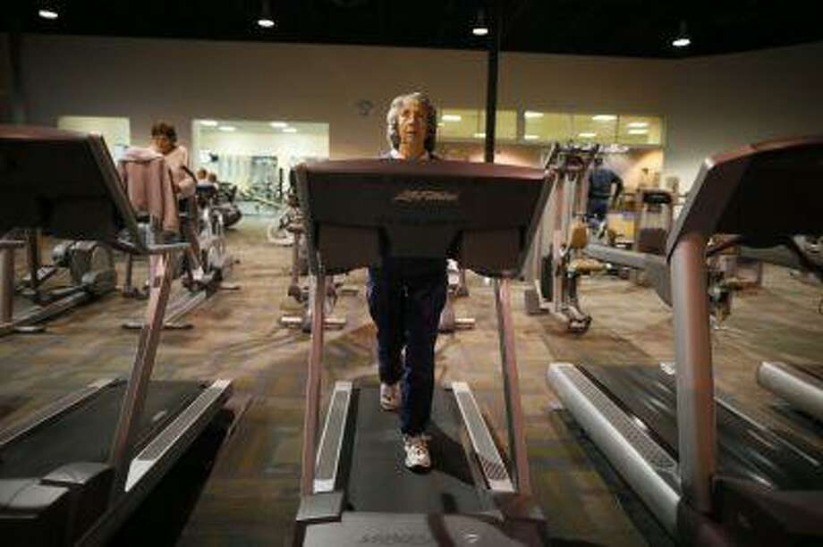 Carol Johnson, 80, works out on a treadmill at a recreation center in Sun City, Arizona, January 5, 2013. Sun City was built in 1959 by entrepreneur Del Webb as America's first active retirement community for the over-55's. Del Webb predicted that retirees would flock to a community where they were given more than just a house with a rocking chair in which to sit and wait to die. Today's residents keep their minds and bodies active by socializing at over 120 clubs with activities such as square dancing, ceramics, roller skating, computers, cheerleading, racquetball and yoga. There are 38,500 residents in the community with an average age 72.4 years. Picture taken January 5, 2013. REUTERS/Lucy Nicholson (UNITED STATES - Tags: SOCIETY)  ATTENTION EDITORS - PICTURE 27 OF 30 FOR PACKAGE 'THE SPORTY SENIORS OF SUN CITY' SEARCH 'SUN CITY' FOR ALL IMAGES Photo: REUTERS / X90050