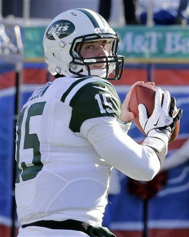 In this Sunday, Dec. 30, 2012 photo, New York Jets quarterback Tim Tebow (15) warms up before an NFL football game against the Buffalo Bills in Orchard Park, N.Y. The New York Jets say, Monday, April 29, 2013, they have waived Tebow. (AP Photo/Gary Wiepert) Photo: AP / AP