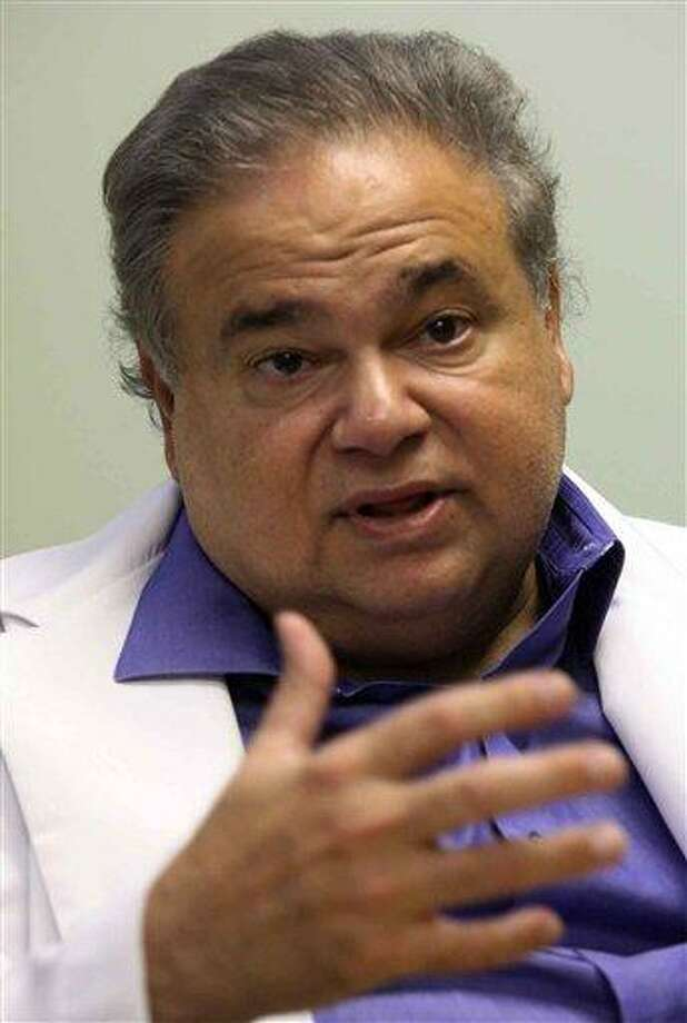 This July 20, 2009 photo shows Dr. Salomon Melgen at his office in West Palm Beach, Fla. Sen. Robert Menendez's office says he reimbursed Melgen, a prominent Florida political donor, $58,500 on Jan. 4 of this year for the full cost of two of three trips Menendez took Melgen's plane to the Dominican Republic in 2010. (AP Photo/The Miami Herald, Hector Gabino) Photo: AP / The Miami Herald