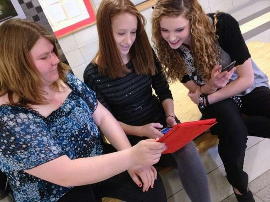 JOHN HAEGER @ONEIDAPHOTO ON TWITTER/ONEIDA DAILY DISPATCH VVS students  Samantha Netzband ,Kelly Breckenridge and Therese Pitman look at an iPad on Friday, April,5, 2013 at The high school in Verona.