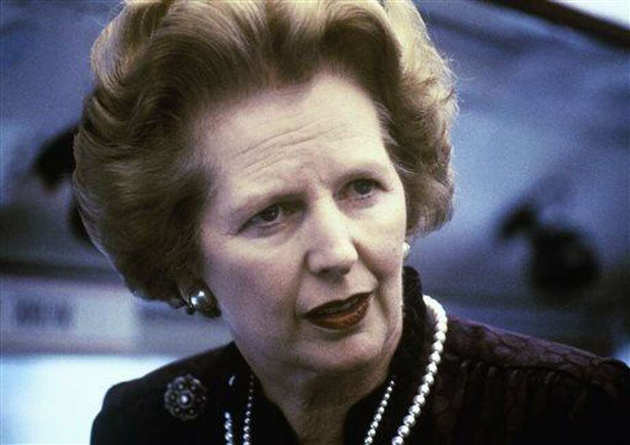 """This is a 1969 file photo showing Margaret Thatcher. Ex-spokesman Tim Bell says that former British Prime Minister Margaret Thatcher has died. She was 87. Bell said the woman known to friends and foes as """"the Iron Lady"""" passed away Monday morning, Aprilo 8, 2013. (AP Photo/File) Photo: ASSOCIATED PRESS / AP1960"""