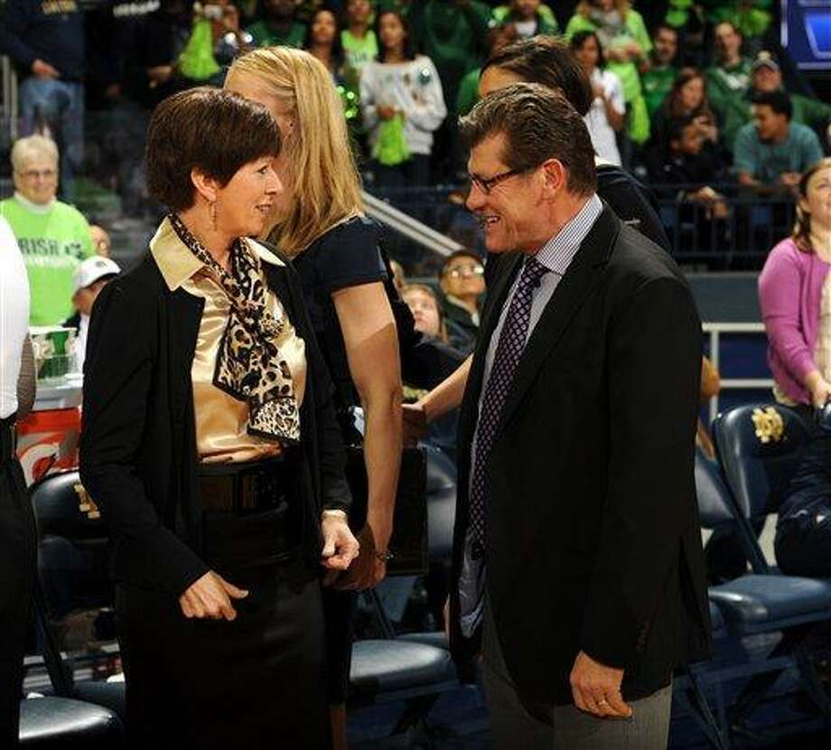 Notre Dame coach Muffet McGraw talks with Connecticut coach Geno Auriemma in an NCAA college basketball game Jan. 7, 2012 in South Bend, Ind. (AP Photo/Joe Raymond) Photo: ASSOCIATED PRESS / AP2012