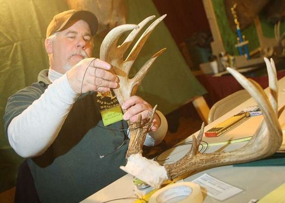 "Dispatch Staff Photo by JOHN HAEGER <a href=""http://twitter.com/oneidaphoto"">twitter.com/oneidaphoto</a> New York State Big Buck Club Measurer Mike Ali measures a set of whitetail deer antlers during the Sportsmen Show at the Kallet Civic Center in Oneida on Saturday, Feb. 2, 2013."