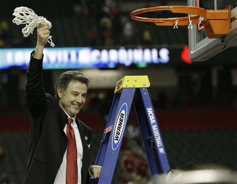 Louisville head coach Rick Pitino celebrates after the team defeated Michigan 82-76 during the NCAA Final Four tournament college basketball championship game, Monday, April 8, 2013, in Atlanta. (AP Photo/David J. Phillip) Photo: ASSOCIATED PRESS / AP2013