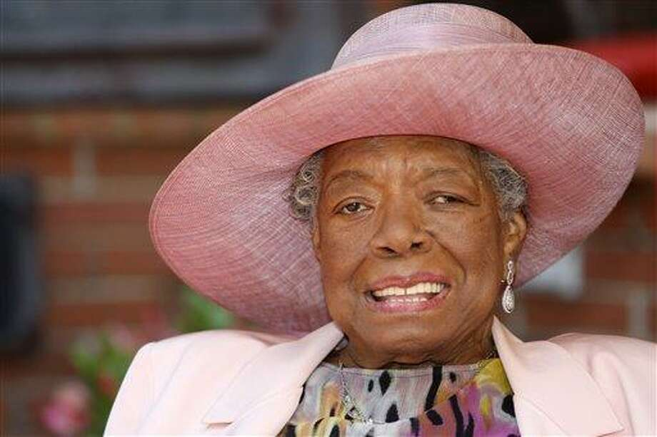 """FILE - In this May 20, 2010 file photo, poet Maya Angelou smiles as she greets guests at a garden party at her home in Winston-Salem, N.C.  In the midst of talking black history with Grammy-winning singer Alicia Keys, Angelou breaks out singing a hymn a cappella. She wants to show Keys, a New Yorker, what """"lining out,"""" call-and-response singing that is popular in Southern black churches, sounds like. That teaching moment is one of many during Angelou's third annual Black History Month program, """"Telling Our Stories,"""" airing on more than 175 public radio stations nationwide throughout the month. (AP Photo/Nell Redmond, file) Photo: AP / FR25171 AP"""