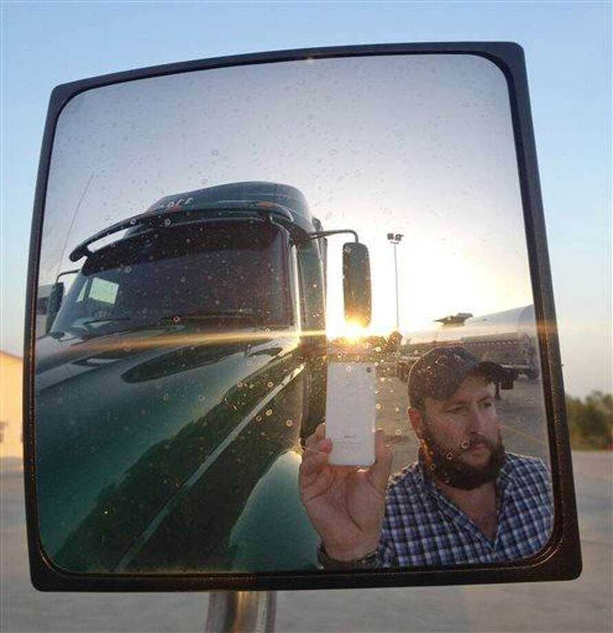 This undated image provided by James Weitze shows a truck driver taking a self portrait on the road. Weitze satisfies his video fix with an iPhone. The Associated Press photo. Photo: AP / James Weitze