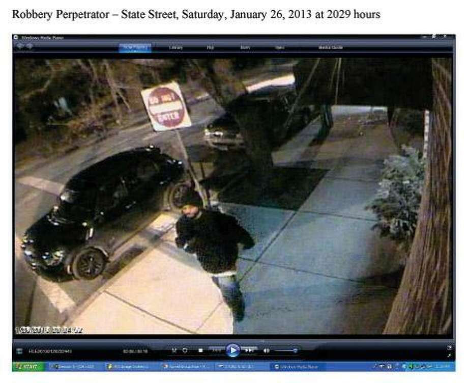 Surveillance photo shows one of the robbery suspects.