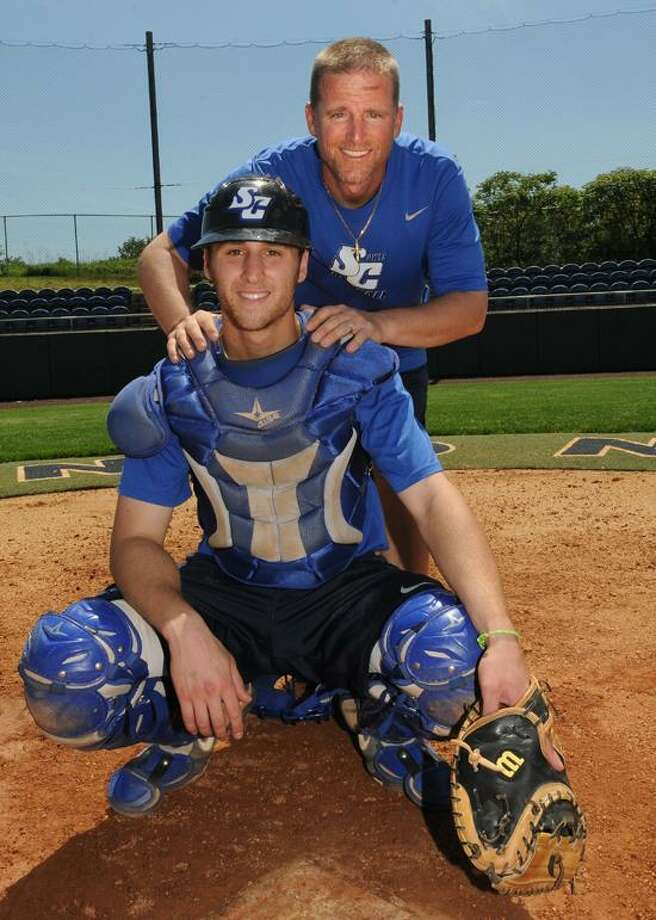 Southern Connecticut State baseball coach Tim Shea, here with his son, Owls catcher T.J. Shea, has been placed on indefinite administrative leave pending an investigation into alleged NCAA violations. (Melanie Stengel/Register)