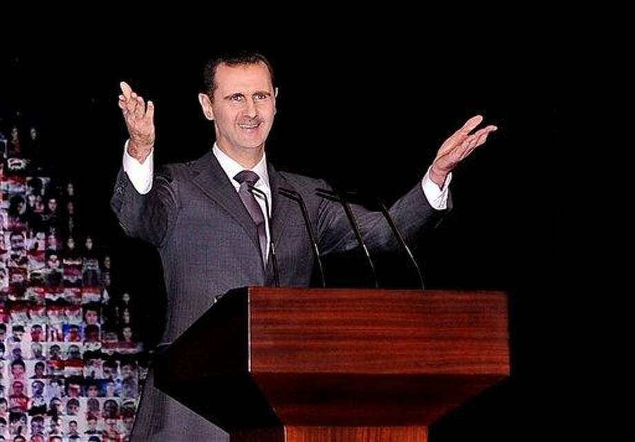 "In this Sunday, Jan. 6, 2013 file photo released by the Syrian official news agency SANA, Syrian President Bashar Assad gestures speaks at the Opera House in central Damascus, Syria. Assad has warned that the fall of his regime or the  breakup of Syria will unleash a wave of instability that will shake the Middle East for years to come. Assad told the Turkish TV station Ulusal Kanal in an interview aired Friday, April 5, 2013 that ""we are surrounded by countries that help terrorists and allow them to enter Syria."" The Associated Press file photo. Photo: AP / SANA"