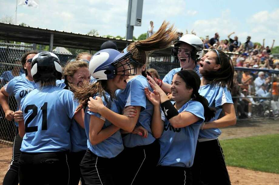 The Oxford Wolverines rush the plate as the winning run crosses the plate in the bottom of the seventh inning to give Oxford the Class S state championship. Oxford defeated Terryville 1-0. (Photo by Sean Meenaghan)