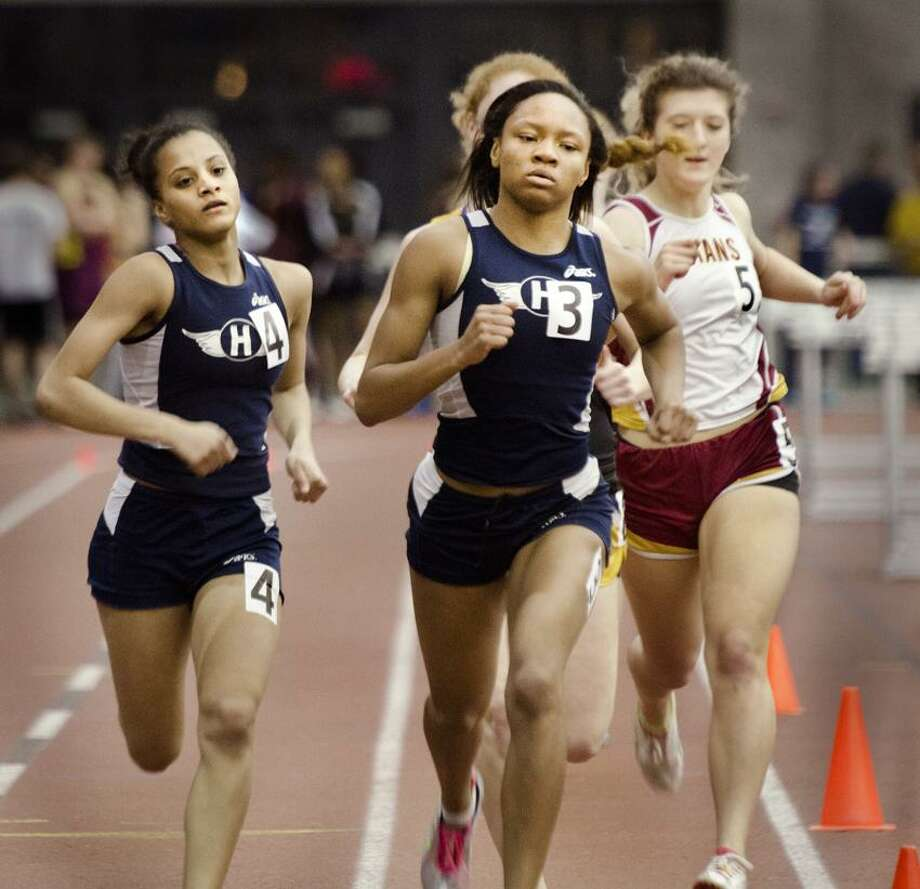 Hillhouse senior Precious Holmes (3) won the 300 and 600 and was a member of the winning 4x400 relay team to help lead the Academics to the SCC indoor track and field team championship Friday at the Floyd Little Athletic Center. (Melanie Stengel/Register)