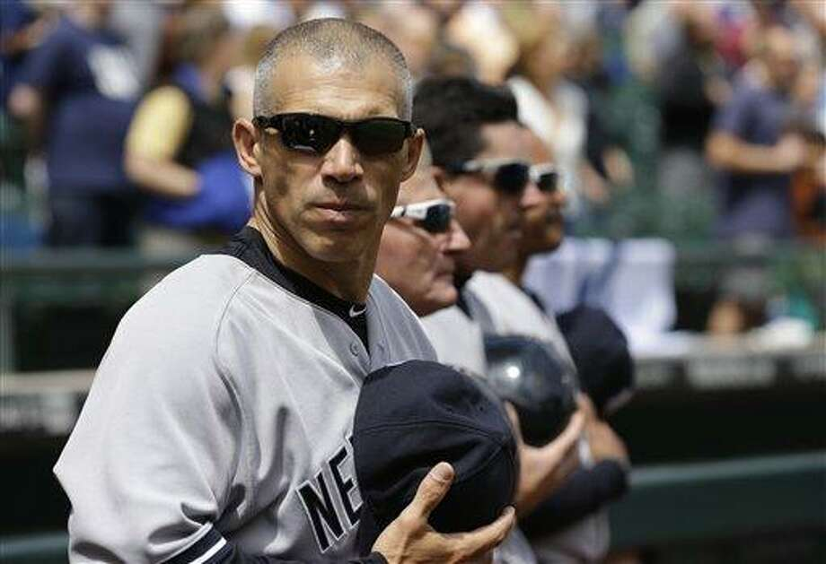 New York Yankees manager Joe Girardi stands during the national anthem before a baseball game against the Seattle Mariners, Sunday, June 9, 2013, in Seattle. (AP Photo/Ted S. Warren) Photo: AP / AP